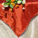 Alkalmi asztalterítő (csont szín) - indás narancs közép