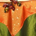 Karácsonyi asztalterítő zöld - csillagos narancs